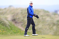 Alex Gleeson (Castle) on the 15th green during Round 3 of the East of Ireland Amateur Open Championship at Co. Louth Golf Club, Baltray on Monday 1st June 2015.<br /> Picture:  Thos Caffrey / www.golffile.ie