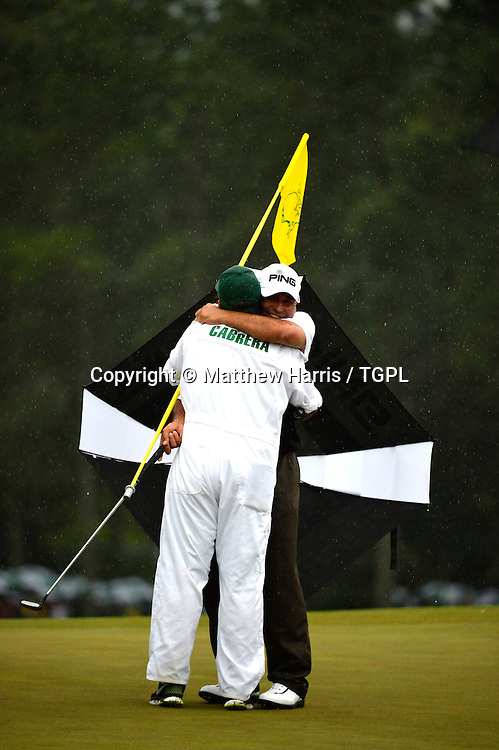 Angel CABRERA (ARG) hugs his son after making the play off V Adam SCOTT (AUS) during fourth round,US Masters 2013,Augusta National,Augusta,Georgia,USA.