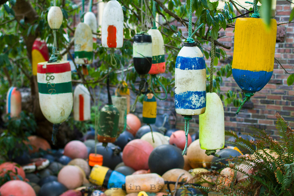 Collection of old crab buoys in yard.
