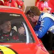 Jamie McMurray and Brian Vickers talk in the garage area during the 56th Annual NASCAR Daytona 500 practice session at Daytona International Speedway on Saturday, February 22, 2014 in Daytona Beach, Florida.  (AP Photo/Alex Menendez)