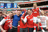 Rotherham United fans delighted with their teams promotion. Skybet football league one play off final match , Leyton Orient  v Rotherham Utd at Wembley Stadium in  London on Sunday 25th May 2014.<br /> pic by John Patrick Fletcher, Andrew Orchard sports photography.