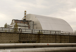 April 26, 2017 - Kiev, Ukraine - A general view of the new protective shelter over the remains of the nuclear reactor Unit 4 at the Chernobyl nuclear power plant, Kiev region, Ukraine, on 26 April 2017.Ukrainians mark the 31th anniversary of Chernobyl's tragedy. The explosion of Unit 4 of the Chernobyl nuclear power plant on 26 April 1986 is still regarded the biggest accident in the history of nuclear power generation. (Credit Image: © Serg Glovny via ZUMA Wire)