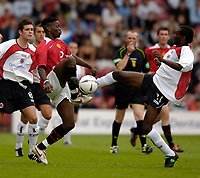 Fotball<br /> England 2005/2006<br /> Foto: SBI/Digitalsport<br /> NORWAY ONLY<br /> <br /> Clyde v Manchester United, Preseason Friendly. 16/07/2005.<br /> <br /> Manchester United's Louis Saha (L) challenges for the ball with Clyde's Romauld Bouadji