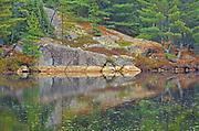 Reflection in the Vermilion River in the Sudbury District flows into Lake Huron<br />Capreol<br />Ontario<br />Canada