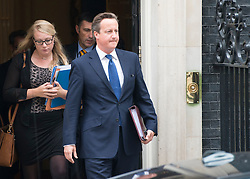 © Licensed to London News Pictures. 03/09/2014. London, UK British Prime Minister David Cameron leaves Downing Street after the COBRA meeting on 3rd September 2014. Photo credit : Stephen Simpson/LNP