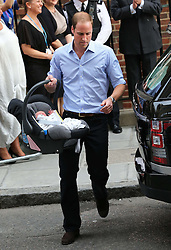 The Duke  of Cambridge with his  new baby boy in a baby carrier as he leaves the Lindo Wing of St Mary's Hospital, London, Tuesday, 23rd July 2013<br /> Picture by Stephen Lock / i-Images