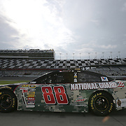 Dale Earnhardt Jr. rests on pit row during the first practice session of the 56th Annual NASCAR Coke Zero400 race at Daytona International Speedway on Thursday, July 3, 2014 in Daytona Beach, Florida.  (AP Photo/Alex Menendez)
