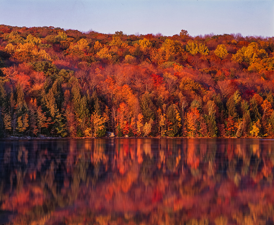Fall reflections of hillside fall foliage, Reuben Hart Reservoir, Litchfield Hills area, CT