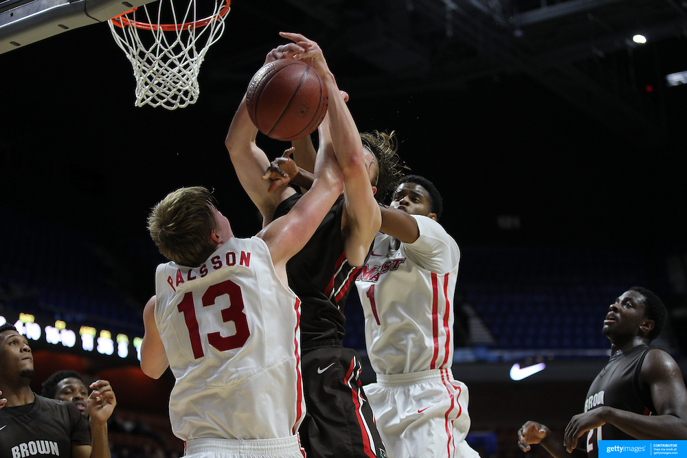 Steven Spieth, (center), Brown, is hit by Kristinn Palsson, Marist, as he rebounds during the Marist vs Brown Men's College Basketball game in the Hall of Fame Shootout Tournament at Mohegan Sun Arena, Uncasville, Connecticut, USA. 22nd December 2015. Photo Tim Clayton