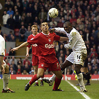 Photo. Jed Wee<br />Liverpool v Middlesbrough, FA Barclaycard Premiership, Anfield, Liverpool. 08/02/2003.<br />Middlesbrough's Geremi (R) grimaces from the force of his challenge with Liverpool's Milan Baros.
