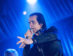 Frontman Nick Cave points to the crowd, of Nick Cave and the Bad Seeds, on stage tonight at The Barrowlands, Glasgow, Scotland.<br /> ©Michael Schofield.