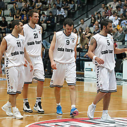 Besiktas's players (Left to Right) Cuneyt ERDEN, Michal Jakub IGNERSKI, Bekir YARANGUME, Serkan ERDOGAN during their Turkish Basketball league derby match Besiktas between Efes Pilsen at the BJK Akatlar Arena in Istanbul Turkey on Saturday 30 April 2011. Photo by TURKPIX