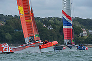 SailGP Team China follows team GBR around the top mark in race one. Race Day. Event 4 Season 1 SailGP event in Cowes, Isle of Wight, England, United Kingdom. 11 August 2019: Photo Chris Cameron for SailGP. Handout image supplied by SailGP