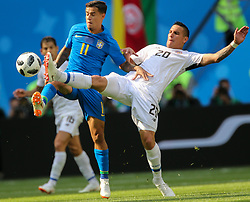 June 22, 2018 - Saint Petersburg, Russia - Philippe Coutinho (L) of the Brazil national football team and David Guzman of the Costa Rica national football team vie for the ball during the 2018 FIFA World Cup match, first stage - Group E between Brazil and Costa Rica at Saint Petersburg Stadium on June 22, 2018 in St. Petersburg, Russia. (Credit Image: © Igor Russak/NurPhoto via ZUMA Press)