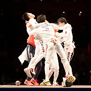 TOKYO, JAPAN - JULY 30:   Koki Kano of Japan is mobbed by team mates after clinching the gold medal in the final round for a 45-36  victory over ROC during the fencing epee team event for men at the Makuhari Messe at the Tokyo 2020 Summer Olympic Games on July 30, 2021 in Tokyo, Japan. (Photo by Tim Clayton/Corbis via Getty Images)
