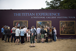 © Licensed to London News Pictures . 21/07/2013 . Suffolk , UK . Piece for the Titian Experience from the National Gallery . The Latitude music and culture festival in Henham Park , Southwold . Photo credit : Joel Goodman/LNP