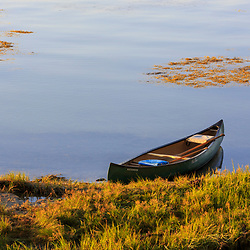 A canoe on the shoreline of Lanes Island in Casco Bay. Yarmouth, Maine.