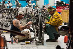 With their choppers waiting outside, Billy Lane of Chopper's Inc (r) with his brother Warren (l) set the timing on another bike for Saturday's Sons of Speed Race of nearly century old boardtrack style bikes at New Smyrna Speeday during Daytona Beach Bike Week. FL. USA. Tuesday, March 14, 2017. Photography ©2017 Michael Lichter.