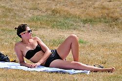 © Licensed to London News Pictures. 07/08/2018<br /> GREENWICH, UK.<br /> People enjoying the hot weather in Greenwich Park, Greenwich.<br /> (permission given)<br /> Photo credit: Grant Falvey/LNP