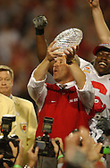 Jim Tressel accepts trophy at Fiesta Bowl in Tempe, AZ.