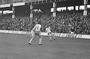 Tyrone kicks the ball towards the goal during the All Ireland Minor Gaelic Football Final, Tyrone v Kerry in Croke Park on the 28th September 1975.
