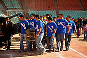 Teammates of Jaime Irigoyen, a 19-year-old baseball player and law student carry his coffin at the Juarez Indios baseball stadium, following a memorial service for the slain youth in Juarez, Mexico January 16, 2009. Irigoyen was reportedly grabbed by the military from his home and found executed the neat mourning. An ongoing drug war has already claimed more than 40 people since the start of the year. More than 1600 people were killed in Juarez in 2008, making Juarez the most violent city in Mexico.    (Photo by Richard Ellis)