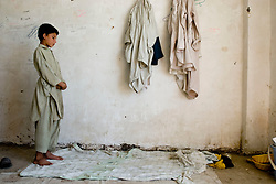 Helmand, 24 Sept 2006..A young Muslim performing Zuhr, the early afternoon prayer, durind the month of Ramadhan in Lashkargah City.