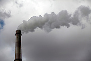 A factory belches out pollutants in central China.