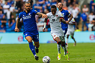 Bournemouth forward Jaidon Anthony  (32) under pressure from Cardiff City midfielder Marlon Pack  (21) during the EFL Sky Bet Championship match between Cardiff City and Bournemouth at the Cardiff City Stadium, Cardiff, Wales on 18 September 2021.