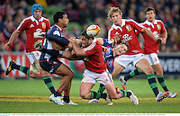 25 June 2013; Jason Woodward, Melbourne Rebels, is tackled by Brad Barritt, British & Irish Lions. British & Irish Lions Tour 2013, Melbourne Rebels v British & Irish Lions. AAMI Park, Olympic Boulevard, Melbourne, Australia. Picture credit: Stephen McCarthy / SPORTSFILE