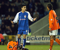 SPORTSBEAT 01494 783165<br /> PICTURE ADY KERRY .<br /> MILLWALL VS CARDIFF CITY<br /> MILLWALL'S TIM CAHILL PLEADS NOT TO BE SENT OFF AFTER FOULING GARETH WALLEY OF CARDIFF CITY'S DURING THEIR DIVISION 1 MATCH AT THE NEW DEN, 7TH APRIL 2004.