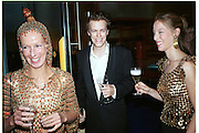 Laure Boulay de la Meurthe, Tom Parker-Bowles and Mr. and Mrs. Andy Wong Chinese Year of the Dragon. Millenium Dome. 29/1/2000.<br />© Copyright Photograph by Dafydd Jones<br />66 Stockwell Park Rd. London SW9 0DA<br />Tel 0171 733 0108. wwwdafjones.com