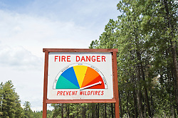 fire danger sign in the Santa Fe, New Mexico forest