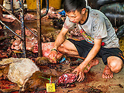 12 SEPTEMBER 2016 - BANGKOK, THAILAND: A man kills a ram during the Qurbani (ritual sacrifice of livestock) at the celebration of Eid al-Adha at Haroon Mosque in Bangkok. Eid al-Adha is also called the Feast of Sacrifice, the Greater Eid or Baqar-Eid. It is the second of two religious holidays celebrated by Muslims worldwide each year. It honors the willingness of Abraham to sacrifice his son, as an act of submission to God's command. Goats, sheep and cows are sacrificed in a ritualistic manner after services in the mosque. The meat from the sacrificed animal is supposed to be divided into three parts. The family retains one third of the share; another third is given to relatives, friends and neighbors; and the remaining third is given to the poor and needy.          PHOTO BY JACK KURTZ
