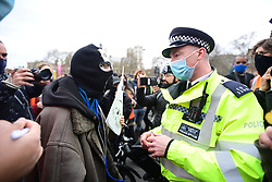 © Licensed to London News Pictures. 03/04/2021. London, UK. Protesters gather in Parliament Square during a Kill The Bill demonstration in central London. A number of campaign groups, including Sisters Uncut and Extinction Rebellion, have come together to form a 'Kill the Bill Coalition', which opposes the introduction of the Police, Crime, Sentencing and Courts Bill. Photo credit: Ben Cawthra/LNP