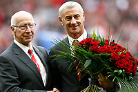 Football - Premier league- Liverpool v Manchester United-Legends Ian Rush an Bobby Charlton swop flowers at Anfield