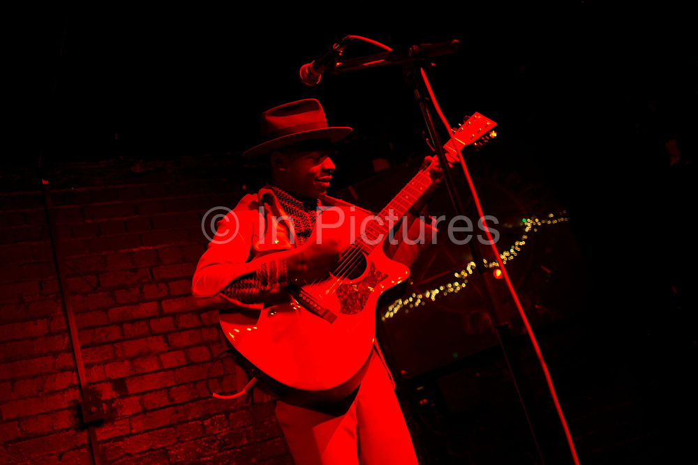 Kenyan American singer songwriter J S Ondara performing at The Slaughtered Lamb in London, England, United Kingdom. J.S. Ondara performed songs from Tales of America, his debut album. Ondara grew up in Nairobi, Kenya, listening to American alternative rock and writing his own songs. In 2013 after his discovery of the music of Dylan, he moved to Minneapolis to pursue a career in music.
