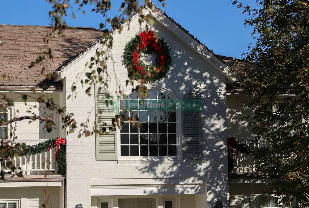 Delighted TV star James Corden has scored his Christmas wish for his family - moving into his luxury mansion in Los Angeles. Corden has moved his family and new baby into the new home - even though workers are still adding the final touches to his renovations. The star made sure that the home had a festive feel too having workers put up decorations around his estate to make his family feel in the festive mood. Noticeable changes are the front of the home, where the torn up driveway lawn has now been replaced with pristine looking turf, understood to be drought resistant grass. Locals say that Corden had carpenters working on the upstairs of the home, along with the back garden. They are delighted that the builders and contractors have removed the giant unsightly rubbish cart, which was parked outside the property. The teams of workmen had been on a tight schedule given that the family were meant to have moved into the home in late September. Corden had hoped, when he bought the home in the spring, that his family would enjoy their first Christmas there - and that dream has come true. His wife Julia, who gave birth to their third child last week, has been overseeing the move from their rented home in Pacific Palisades. While Corden, host of the CBS Late Late Show, has been working, she has been instructing cleaners, electricians, landscapers and gardeners at the lavish home. The good news for Corden is that he had saved plenty of cash from the $10m house purchase. The shrewd entertainer negotiating a whopping $1.25m off its original asking price and has now used that saved cash to renovate his place. The former Gavin and Stacy actor is just two and half years into his run as a late night US TV host after locking in a five year deal. He publicly has said that he has no idea whether he will remain in Los Angeles, but his purchase and extensive renovation plans seem to indicate he is in for the long haul. At least ten workmen are carr. 24 Dec 2017 Pictured: Photo credit
