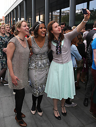 © Licensed to London News Pictures. 11/10/2015. London, UK. Volunteers take a selfie as they rehearse an attempt to break the world record for the largest number of people dancing the Charleston at Spitalfields. Photo credit: Peter Macdiarmid/LNP