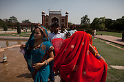 Visitors are enjoying a day at the Taj Mahal building, in Agra.