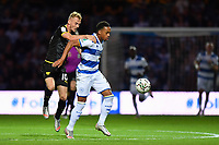 Football - 2021 / 2022 EFL Carabao Cup - Round Two - Queens Park Rangers vs Oxford United - Kyan Prince Foundation Stadium - Tuesday 24th August 2021.<br /> <br /> Chris Willock of Queens Park Rangers holds off the challenge from Mark Sykes of Oxford United.<br /> <br /> COLORSPORT/Ashley Western