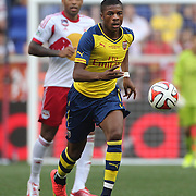Chuba Akpom, Arsenal,  watched by Thierry Henry, New York Red Bulls, in action during the New York Red Bulls Vs Arsenal FC,  friendly football match for the New York Cup at Red Bull Arena, Harrison, New Jersey. USA. 26h July 2014. Photo Tim Clayton