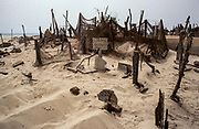 St Louis, fishing community of Guet N'Dar. Fishermen cemetery on the dunes near the sea. The tombs are made of wood of old boats and nets.