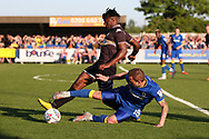 AFC Wimbledon midfielder Dean Parrett (18) performing a sliding tackle during the EFL Sky Bet League 1 match between AFC Wimbledon and Bury at the Cherry Red Records Stadium, Kingston, England on 5 May 2018. Picture by Matthew Redman.