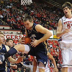 Notre Dame Fighting Irish guard/forward Pat Connaughton (24) beats Rutgers Scarlet Knights forward Gilvydas Biruta (55) to a rebound during Big East NCAA action during Rutgers' 65-58 victory over Notre Dame at the Louis Brown Athletic Center in Piscataway, N.J.