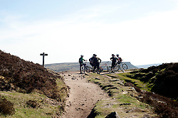 A group of mountain bikers stop to admire the view of Derwent Reservoir from Derwent Edge in the Peak National Park..http://www.pauldaviddrabble.co.uk.25 March 2012 .Image © Paul David Drabble