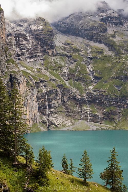 Glacier-fed waterfalls above Oeschinensee Lake, Via Alpina, Swiss Alps