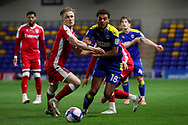 AFC Wimbledon defender Nesta Guinness-Walker (18) dribbling and battles for possession during the EFL Sky Bet League 1 match between AFC Wimbledon and Gillingham at Plough Lane, London, United Kingdom on 23 February 2021.