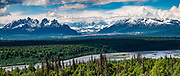 Tokosha Mountains seen from Curry Ridge, in Denali State Park, Alaska, USA. Denali State Park is in the Matanuska-Susitna Borough adjacent to the east side of Denali National Park and Preserve along the Parks Highway. This image was stitched from multiple overlapping photos.
