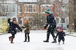 © Licensed to London News Pictures. 24/01/2021. London, UK. Annie 8 years old, Rose 6 year old and Clara 1 year old play in the the snow with their dad in north London as large parts of the UK are expected to be blanketed in snow and freezing conditions. According to the Met Office, the cold weather could bring up to 10cm of snow to some parts of the country and an amber weather warning for snow and ice is in place across much of the UK. <br /> <br /> ***Permission Granted***<br /> <br /> Photo credit: Dinendra Haria/LNP